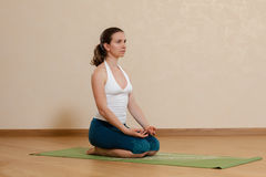 caucasian-woman-practicing-yoga-studio-vajrasana-38318469
